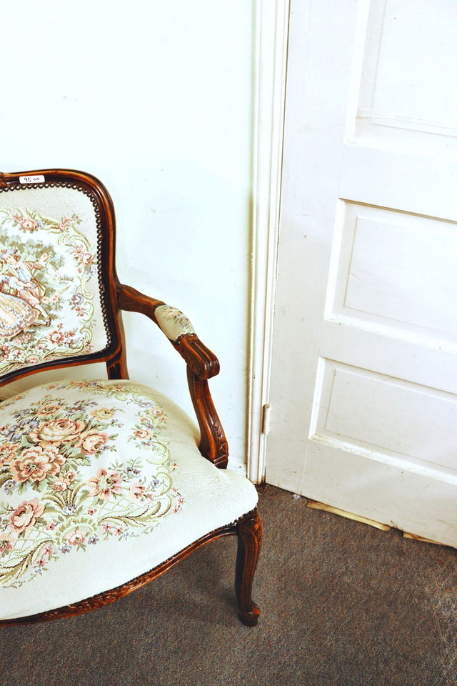 A beautiful example of upholstery o a wooden chair.