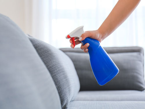 Upholstery being protected by an anti-stain spray